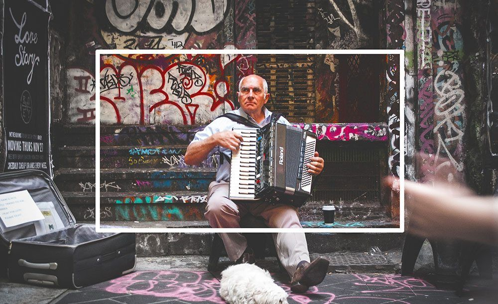 Image of man playing accordion showing color enhancements using Filters 3 Recolor